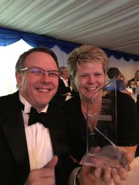 Gary Gardner & Tracey Williams with the award